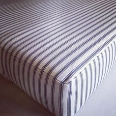 Classic Ian Mankin ticking stripe fabric on a bench seat cushion (Ticking #1 in Dark Navy)