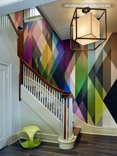 Circus wallpaper from Cole & Son transforms this simple staircase into a stunning feature. The overlapping diamond shapes draw your eye up and round. | Gruber Home Remodelling via houzz