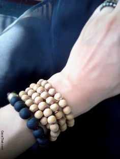 Wearing DIY handmade perfumed wooden beaded bracelets for Summer