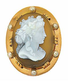 A hardstone and pearl pendant   The oval hardstone cameo of a female bust in profile, within a polished surround accented with pearls, pearls have not been tested for natural origin, 4.1cm long