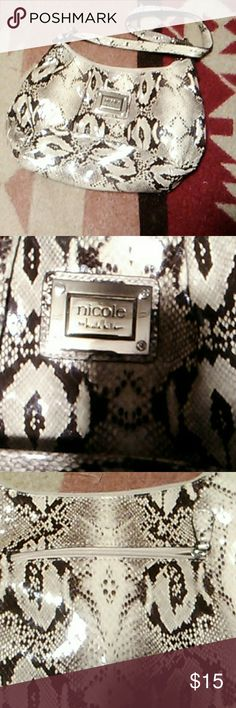 Fake snakeskin purse It is a fake snakeskin purse. inside there is a zip pocket, plus three little pockets on the inside. And a big pocket on the back. In like new condition. Nicole by Nicole Miller Bags Shoulder Bags