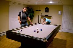 The recreation room at Clarity Way is equipped with a pool table, ping pong table, games, and more!