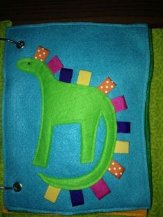This website has a lot of great ideas for quiet books.  I love this simple dinosaur for a baby's quiet book.