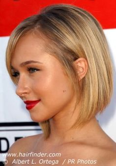 The hybrid between a bob and a round cut features a refreshing asymmetry in front. The hair was cut in a steep angle from the high side partition to the ends, which were textured for a softer line around. The crown was lifted by teasing and combing hair backwards.