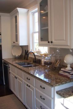 kitchens - Santa Cecilia granite Lowes drawer pulls and knobs T.J. Maxx apocathary jars white cabinets Kitchen white cabinets, santa Cecilia