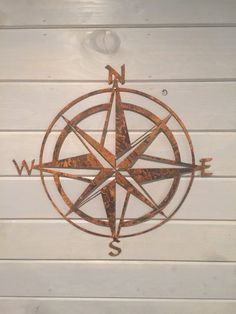 For sale is a Nautical Compass cut out of 16 gauge steel. This mainstay of saltwater decor is 22x22 and is available in three different finishing options. This is a perfect piece for any man cave or for that person looking for pirate decor. You have many options for finishes.