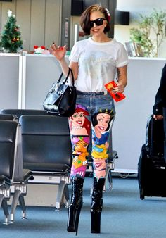 Lady Gaga pays tribute to Ariel, Snow White, Cinderella and Jasmine with some eye-catching denim arriving at Narita International Airport.