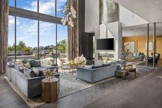 John Legend and Chrissy Teigen's Beverly Hills Home Hits Market for $23.95 Million Large Family Rooms, Home And Family, Rihanna, Chrissy Teigen John Legend, Beverly Hills Mansion, Concrete Fireplace, Villa, Glam Room, House On A Hill