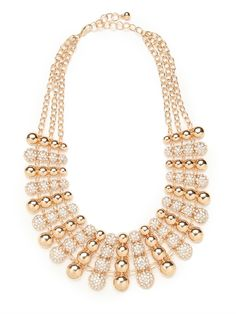 Delight in the two-tone allure of this graphic bib necklace. With that mix of metal and pavé finery, it's plenty audacious and mesmerizing, too.