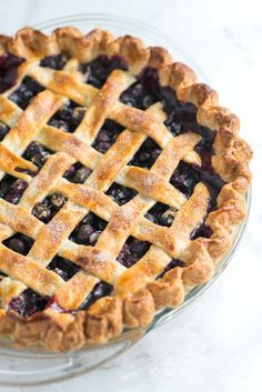 Easy Homemade Blueberry Pie Recipe - Toss, Fill and Bake Easy with Trader Joe's Pie Crust. Cut strips in 1 cm strips for lattice. Used frozen thawed blueberries. Weighed instead of measured. Don't use pie shield in first 20 minutes of baking or shield will stick to crust. Needed to bake an additional 10 minutes before filling bubbled.