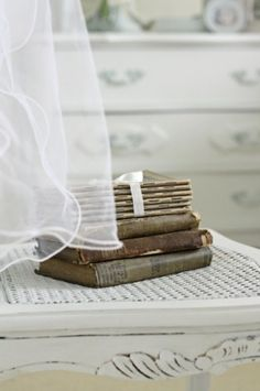 vintage books Love the sheer curtain, the soft antique desk and the star- books
