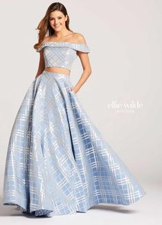c7c25b71b32 Ellie Wilde for Mon Cheri is a formal two piece off the shoulder Jacquard  pattern long Prom gown with skirt pockets.