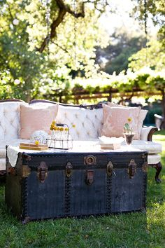 DECORATING WITH VINTAGE TRUNKS: #backyard built for a #garden party with sofa + trunk coffee table