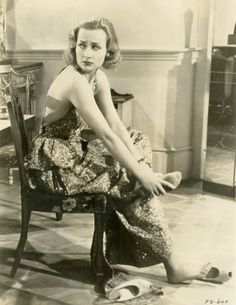 Carole Lombard massaging her achy arches