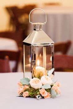 Silver Lantern , candle & flowers