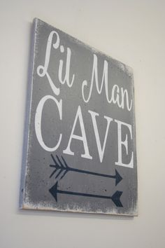 Lil Man Cave!  This is a wood sign that is available in several different sizes - 12 x 14, 14 x 18, 16 x 20 or 20 x 24.  The background is painted Gray.  Words are White and arrow design is Navy.  This piece is handpainted and sanded for a distressed/vintage look.  It is then sealed with water base