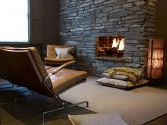 Dark stone fireplace offers an intimate setting - Decoist