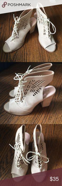 Cutout heels Never worn. Light tan color Shoes