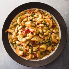 Shrimp and bright flavors transform cannellini beans from winter to all-weather fare.