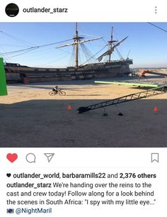 Hahahaha, wonder who that red headed man is that is riding the bike......I spy Sam Heughan  - Cape Town, Africa - Outlander - April 3rd, 2017
