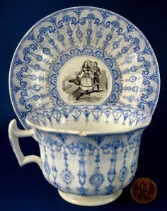 Early Staffordshire  blue and black soft paste porcelain transfer or transferware tea cup and saucer in the New London shape, made from 1850 to the 1870s.