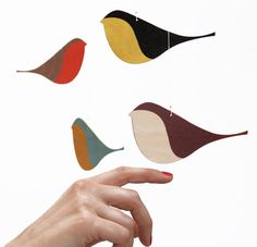 SNUG.SONGBIRDS mobile with 6 wooden printed songbirds. http://snugonline.bigcartel.com/product/snug-songbirds-wooden-mobile