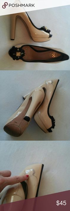 Vince Camuto peep toe real lether heels Authentic. Gently used. Some signs of wear. Real patten leather. Pale pink black. High heels. Easy to walk in since heel is thick. Pinup classy comfortable Vince Camuto Shoes