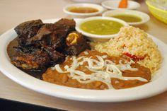 Birria estilo Michoacan (steamed goat in mole) con arroz y frijoles.