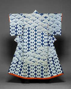 Kosode with Design of Pines and Interlocking Squares Period: Edo period (1615–1868) Date: second half of the 18th century Culture: Japan Medium: Tie-dyed (shibori) pattern on figured silk satin (rinzu) Classification: Costumes. This garment's design juxtaposes interlocking squares with gently diagonal passages of pines, in their conventionalized cloudlike form. The entire pattern was rendered in a resist-dyeing technique called kanoko (literally, fawn) shibori,