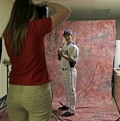 Texas Rangers starting pitcher Derek Holland wears a team USA World Baseball Classic jersey as he poses for pictures during photo day at baseball spring training  Wednesday, Feb. 20, 2013, in Surprise, Ariz. (AP Photo/Charlie Riedel)