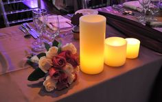 Luminaries and Floral Table Decor  www.tradesensation.com