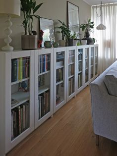 Love this! Perfect for a small room because they are so narrow. :) BILLY bookcases with GRYTNÄS glass doors   IKEA Hackers