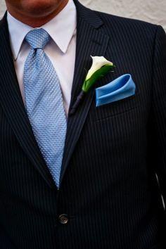 Dark navy pinstripe suit + powder blue textured tie + solid light blue handkerchief + white calla boutonniere