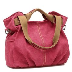 """Everyone needs a durable canvas for summer adventures and beyond! This 100% cotton satchel fits the bill perfectly. The perfect size to accommodate all of your essentials, it also comes with aFREE RFID-blocking wallet case that shields you from identity theft.14"""" wide x 8"""" deep x 12"""" highInterior has 1 zippered and 2 wall pocketsExterior has 1 zippered and 2 side pocketsTop zipper closureHandles for hand or shoulder carryingIncludes 30"""" strap for crossb..."""