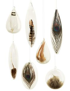 Our favorite ornaments! Gorgeous and exotic fluffy feathers lay nestled inside mouth-blown hollow glass spheres and icicles. Wonderful for window displays or dangling from a doorway any time of the year.  These Roost Floating Feather Ornaments are available at ShopNectar.com