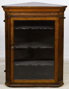 Lot 647: Pine Corner Cupboard; Having a mahogany front with three scalloped interior shelves