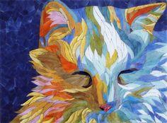 Beautiful cat quilt.