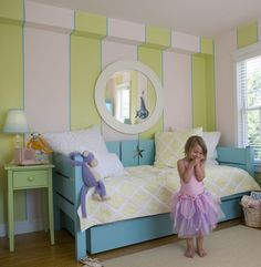 such a pretty room for a little girl! Love the wall, the colors, and the detail on the bed frame!