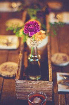 Rustic centerpiece with wood flower box.