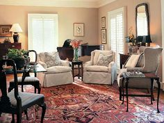 Although there's a lot of white, the room still looks warm and cozy...love the rug, floor, dark wood pieces, accessories