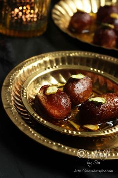 Learn how to make Gulab Jamun  ~ An Indian confection of deep fried spongy milk balls soaked in rose scented and cardamom flavoured sugar...