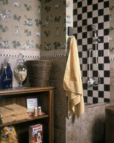The ultimate dog grooming area. The wallpaper is done in dogs, and there's a shelf for dog treats.