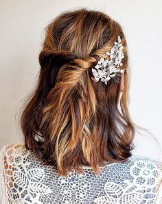 Girls with medium-length locks can try this simple hairstyle. Add some texture to your hair by using a dry texturizing spray (we love Oribe's version) then take two small sections from the front, and twist back. Secure with hair pins, then add a festive hair accessory to finish off the look! via StyleListCanada