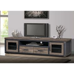 The transitional vintage style of this Heritage Rusticentertainment quickly becomes the focal point of your home decorwith its distressed brown gray finish. The ample storagecompartments and sturdy su