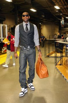 LeBron James dressed business waist up and casual waist down!  Interesting combo (especially with those fresh white kicks)! #pgf #nbafashion