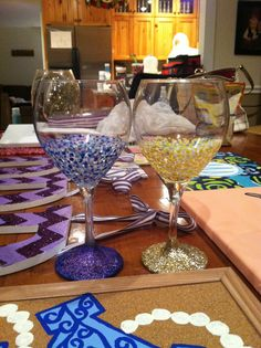 Blue and gold painted wine glasses with glitter bottom