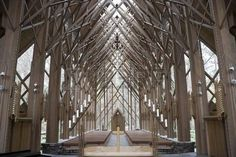 The insides of a wooden and glass church from the alter Stock Photo