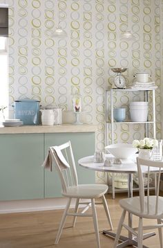 Cool in more ways than one, this 1973 wallpaper is teamed with Aquamarine (cupboards) and Linen Wash (chairs).