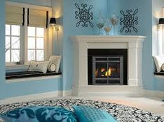 corner fireplace decor like the asymmetrical wall decor