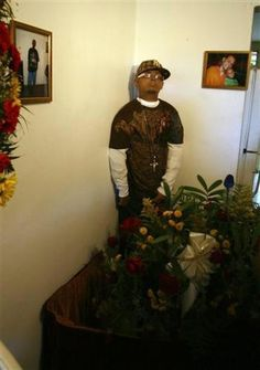 Dead Man Standing - It was 24-year-old Angel Pantoja Medina wish to stand at his own funeral and when this man was found dead, his grieving family made that wish come true.  After being embalmed, his corpse was propped up for his three-day Wake in his mother's living room dressed in his favorite Yankees cap and sunglasses.